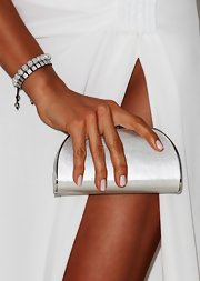 Irina accessorized her tan arms with this rhinestone bracelet.