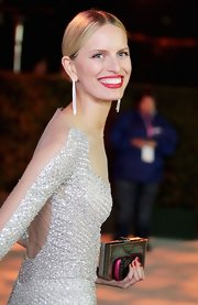 Karolina Kurkova attended the Elton John Oscar viewing party wearing a pair of channel-set white diamond earrings featuring over 300 diamonds set in white gold.