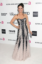 Danica McKeller  flaunted her figure in an Alberto Makali mermaid gown glittering with sequins and beads.
