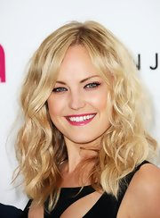 Main Akerman wore her hair in a tousled mass of shiny waves at the Elton John Oscar viewing party.