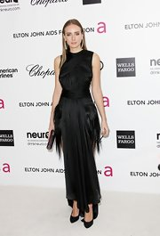 Olga Sorokina complemented her black gown with classic pumps.