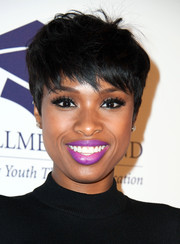 Jennifer Hudson injected a jolt of color to her look with bright purple lipstick.