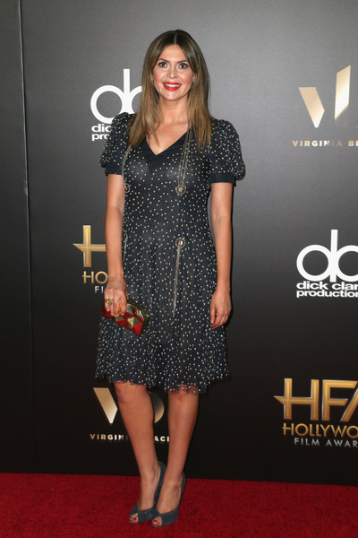 Carly Steel chose a dotted cocktail dress with puffed sleeves and chain detailing for her Hollywood Film Awards look.
