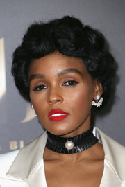 For her lips, Janelle Monae chose an eye-popping red hue.