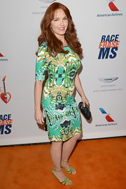 Amy Yasbeck showed off her curves with this bright and bold green printed dress.