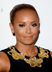 Mel B kept her look mild and sleek with this slicked back bun.
