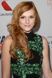 A barely-there nude lip gave Bella Thorne just the right amount of shine and color for a minimal radiant beauty look.