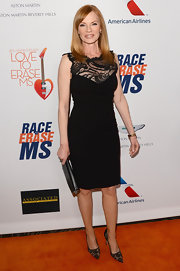 Marg showed off her curves with this elegant black dress that featured a lace neckline.