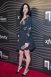 Krysten Ritter amped up the glitter with a crystal tube clutch.