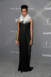Sonequa Martin-Green was diva-glam in a black Adam Selman halter gown with a feathered neckline at the Costume Designers Guild Awards.