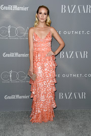 Anna Camp paired her pretty dress with a nude box clutch by L.K.Bennett.