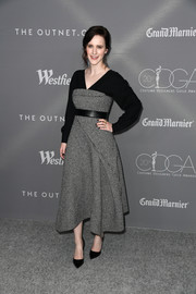 Rachel Brosnahan went for easy sophistication in a layered gray and black midi dress by ADEAM at the Costume Designers Guild Awards.