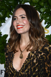 Mandy Moore paired her plunging outfit with an oversized pendant necklace by Beladora.