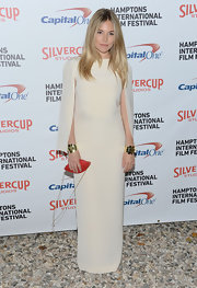 Sienna Miller looked magnifique in her white cape-sleeved dress at the Hamptons International Film Festival.