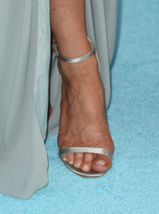 Jennifer Aniston walked the Critics' Choice Awards blue carpet in silver satin heels by Jimmy Choo.