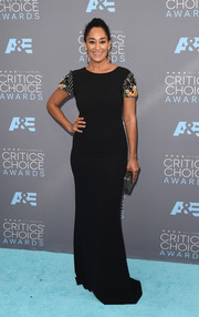 Tracee Ellis Ross showed off her shape in a form-fitting black Randi Rahm gown with embellished sleeves at the Critics' Choice Awards.