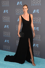 Rosie Huntington-Whiteley injected a hint of shimmer via a pair of silver ankle-strap sandals, also by Saint Laurent.