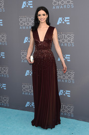 Krysten Ritter was statuesque and sophisticated at the Critics' Choice Awards in a maroon Zuhair Murad Couture gown featuring a plunging neckline, a beaded midsection, and a pleated skirt.