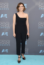 Rachel Bloom was minimalist-chic in a black one-shoulder jumpsuit by Alexander McQueen at the Critics' Choice Awards.