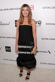 Nina Garcia attended the Elton John Academy Awards viewing party wearing a strapless black dress with a fur hem.