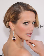 Petra Nemcova opted for simple elegance at Elton John's 2013 Oscar bash with diamond drop earrings.