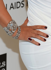 Kim Kardashian rocked a very on-trend oxblood manicure at Elton John's 2013 Oscars after-party.