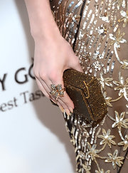 Emma Roberts topped off her Oscar-party look with a bronze crystal clutch.