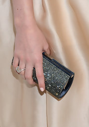 Christa B. Allen added a pop of color to her nude evening gown with this gunmetal crystal clutch.