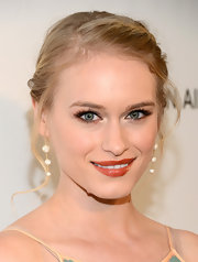 A trio of white diamond drop earrings topped off Leven Rambin's Oscar-night look.