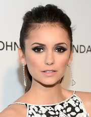 Nina Dobrev looked elegant at a 2013 Oscar party with a pair of triangle cut diamond drop earrings.