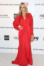 Mena Suvari opted for red for her Oscar-party look with this long-sleeved gown with plunging neckline.