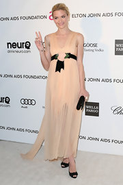 Jaime King looked soft and ethereal in a peach flowing gown with a floral belt.
