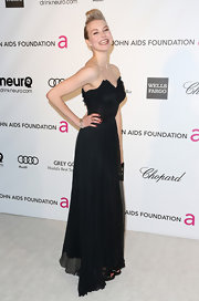 Penelope Mitchell showed off her slender figure with a column-style black strapless dress with flowing skirt.