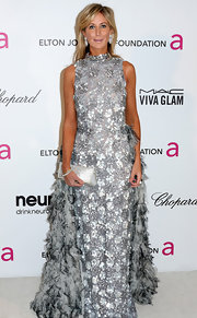 Lady Victoria Harvey showed her classic taste at the Elton John Oscar party with a silver gown with ruffles and floral embellishments.
