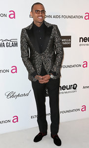 Chris Brown looked extra slim at Elton John's party while wearing a pair of black slacks.
