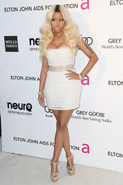 Nicki Minaj showed some leg in a white mini dress, which she wore to Elton John's Oscar party.
