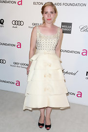 Sara Rafsky opted for a feminine tiered dress with bow embellishments for her evening look.