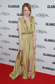 Emma Stone was decked out in Lanvin for the Glamour Awards red carpet, pairing her shining pleated gown with a gold chain shoulder bag.