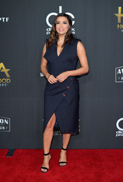 Eva Longoria was modern in an asymmetrical navy tuxedo dress by Mario Dice at the Hollywood Film Awards.