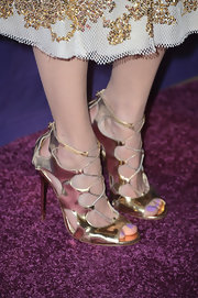 Emmy Rossum paired these cool gold heels with her beaded frock for a soft, but edgy red carpet look.