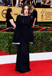 Lorelei Linklater went for Morticia Addams-inspired goth in a bell-sleeve black Honor dress during the SAG Awards.