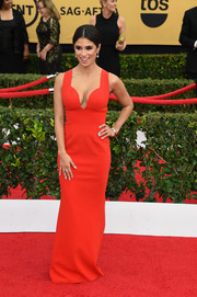 Diane Guerrero flaunted major cleavage in a low-cut red gown during the SAG Awards.