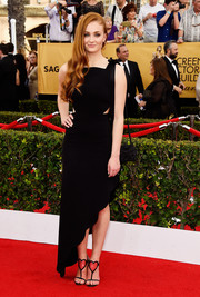 For her SAG Awards look, Sophie Turner kept it simple and sweet with this Osman LBD featuring waist cutouts, a scalloped, asymmetrical hem, and beribboned shoulder straps.