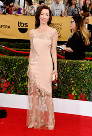 Molly Parker looked ethereal at the SAG Awards in a nude Lorena Sarbu gown with a sheer skirt and sleeves and delicate floral beading.