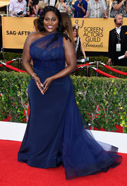 Danielle Brooks looked like royalty at the SAG Awards in this stunner of a gown, a blue Christian Siriano one-shoulder design with a tulle bodice overlay that cascaded down into a frothy train.