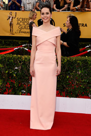 For her SAG Awards look, Felicity Jones chose a pale-pink Balenciaga off-the-shoulder column dress with architectural crisscross detailing.