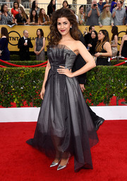 Nimrat Kaur cut an ultra-girly silhouette at the SAG Awards in a Toni Maticevski strapless dress featuring sheer black fabric over a white underlay.