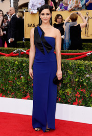 Melissa Fumero attended the SAG Awards wearing an artful blue and black one-shoulder gown by Maxime Simoens.