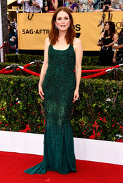 Julianne Moore exuded vintage glamour in a beaded emerald-green gown by Givenchy Couture during the SAG Awards.