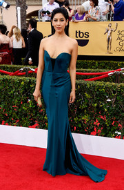 For her SAG Awards look, Stephanie Beatriz chose a teal Johanna Johnson strapless gown with a dangerously low neckline.